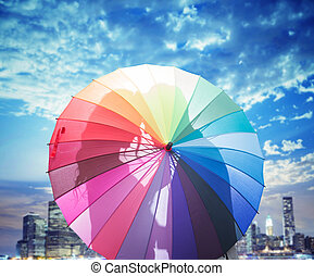 Conceptual picture of a couple kissing behind an umbrella