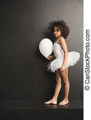 Conceptual picture of a little ballet dancer with a ballon