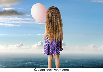Conceptual picture of a little girl with a balloon