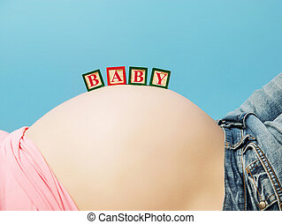 conceptual picture of a pregnant's lady belly
