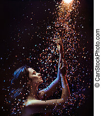 Conceptual picture of a woman among pieces of crystal