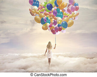Conceptual picture of a woman holding hundreds of balloons