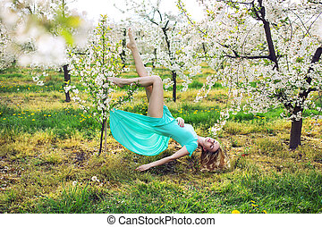 Conceptual picture of a woman levitating in the garden