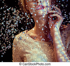Conceptual picture of a woman looking at the sequin rain