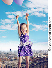 conceptual picture of girl flying with the balloons