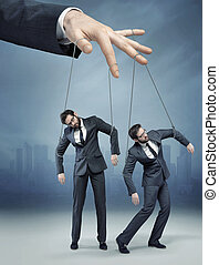 Conceptual picture of the human marionette - Conceptual...