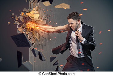 Conceptual portrait of a clever businessman beating a barrier