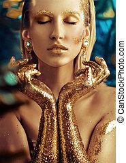 Conceptual portrait of a golden woman - Conceptual portrait...
