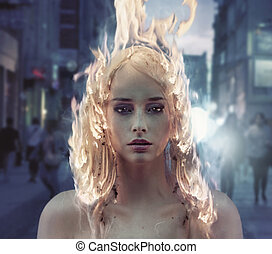 Conceptual portrait of a lady with burning hair - Conceptual...