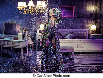 Conceptual portrait of a sensual lady in the middle of the storm in a bedroom