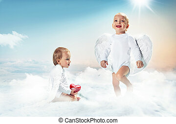 Conceptual portrait of a two cute cupids on the cloud