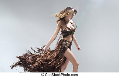 Conceptual portriat of the woman wearing dress made of hair...