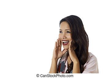 Conceptual shot of Asian girl screaming good news