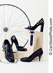 Conceptual still-life with shoes and wheel