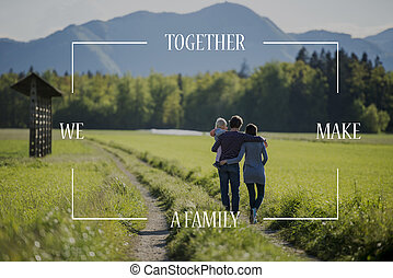 Conceptual text over young family on a country road