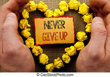 Conceptual writing showing Never Give Up. Business photo showcasing Motivation Quote For Success Achievement Challenge written on Sticky Note Paper With Heart Holding Hand with Finger