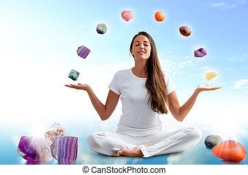 Conceptual yoga with gemstones.