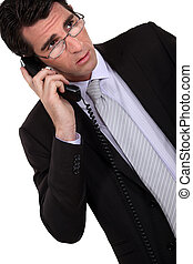 Concerned businessman talking on the phone