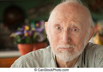 Concerned elder - Concerned senior man at home in his house