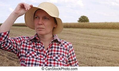 Concerned farmer planning new seeding season, female farmer...