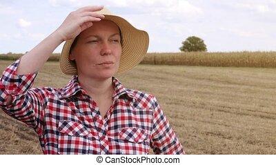 Concerned farmer planning new seeding season, female farmer...
