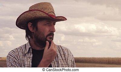 Concerned farmer planning new seeding season, male farmer...