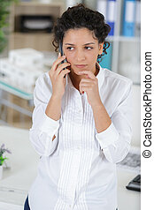 concerned female architect on the phone