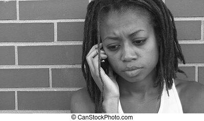 Concerned girl on cellphone. - A girl listens to her...