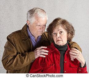 Concerned Husband - Concerned mature husband comforting...