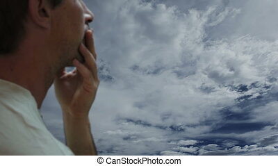 Concerned Man Timelapse Clouds - A middle aged man in...