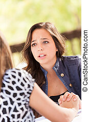 Concerned Young Adult Woman Talking With Her Friend