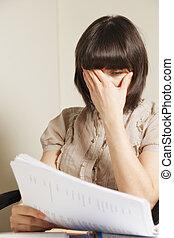 Concerning report - Young caucasian brunette businesswoman ...