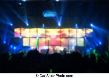 Concert blurry de-focused on background.