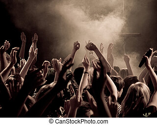 Concert - Crowd at a concert with hands up in the air