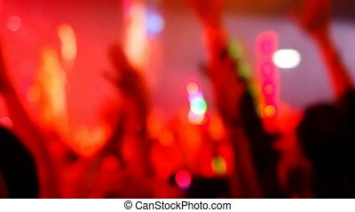concert crowd in hall - blurred focused concert crowd in...