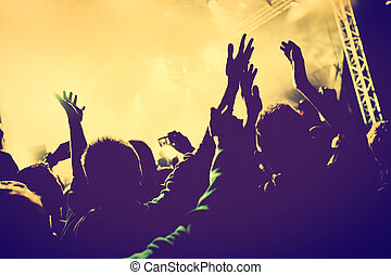 Concert, disco party. People with hands up in night club. - ...