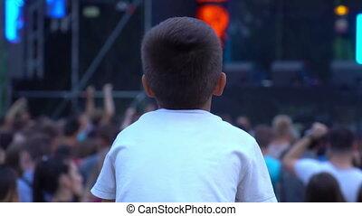 Concert kid child festival - Fan kid on father shoulders...