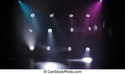 Concert lights. Lighting effects on a theater stage at night. Stage lights shine in the circus arena. Lighting equipment with multicolored beams