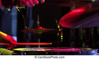 Concert of rock band. Drummer playing on stage - Concert of...