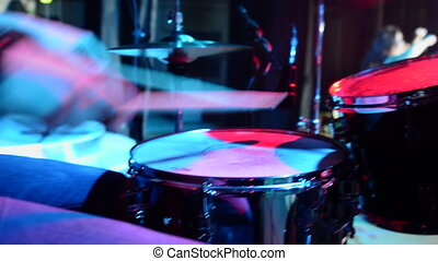 Concert of rock band. Drummer playing on stage