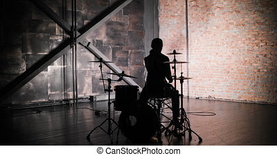 Concert rock band performing on stage with singer performer, guitar, drummer. Music video punk, heavy metal or rock group