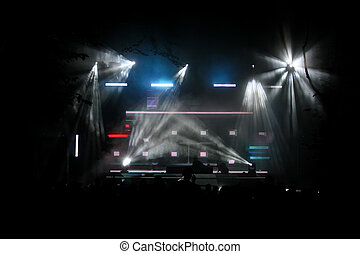 Concert stage at night with lighting equipment