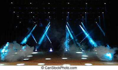 Concert stage - Illuminated empty theater stage with fog and...