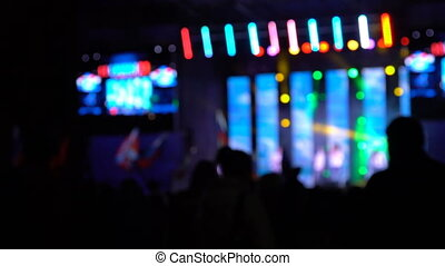 Concert venue at night in colorful lights