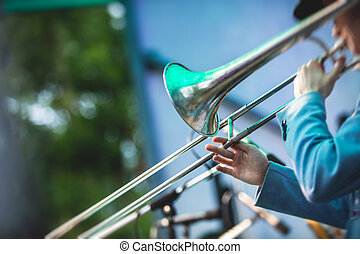 Concert view of a trombone player trombonist with musical jazz band performing