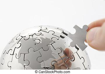 concetto affari, con, uno, mano, costruzione, puzzle, globo, bianco, spazio, per, messaggi