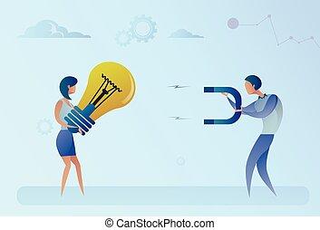 concetto, affari, luce, idea, magnete, holding donna, rubare, bulbo, uomo