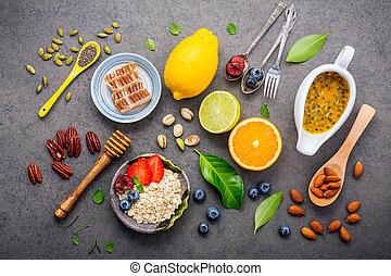 concetto, arancia, cibi, set, mandorle, chia, ingredienti, fondo., frutte, mirtillo, cibo, scuro, noci, miele, fondo, .the, bacche, pietra, sano, su, farina avena, semi, mescolato