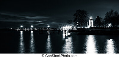Concord Point Lighthouse and a pier at night in Havre de Grace, Maryland.