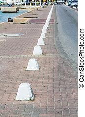 Concrete Barriers by Road on Sidewalk